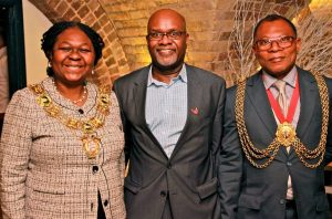 John James shows off his Sickle Cell Society pin, as the mayors of Southwark and Lambeth show off their equally-famous jewellery!